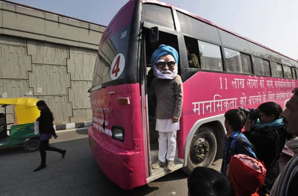 An activist dressed as Indian Prime Minister Manmohan Singh stands on a pink bus meant to spread awareness on violence against women, in New Delhi.