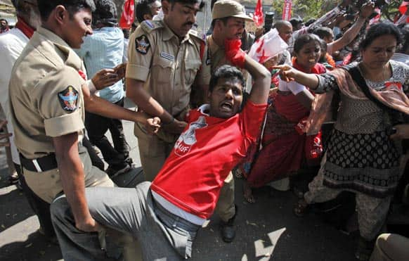 Police detain a left wing party activist during a protest against power tariff hike in Hyderabad. Left wing parties are demanding withdrawal of hike in electricity charges and cooking gas price.