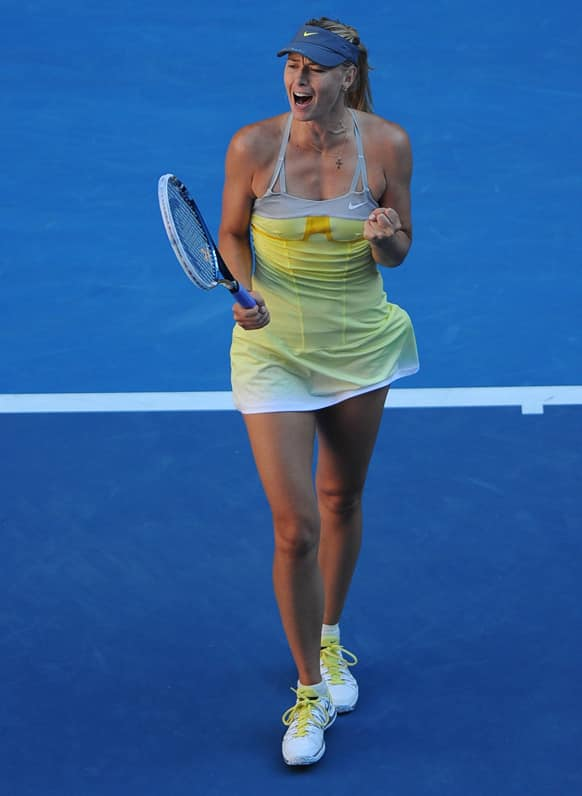 Russia`s Maria Sharapova celebrates after defeating compatriot Ekaterina Makarova in their quarterfinal match at the Australian Open tennis championship in Melbourne.
