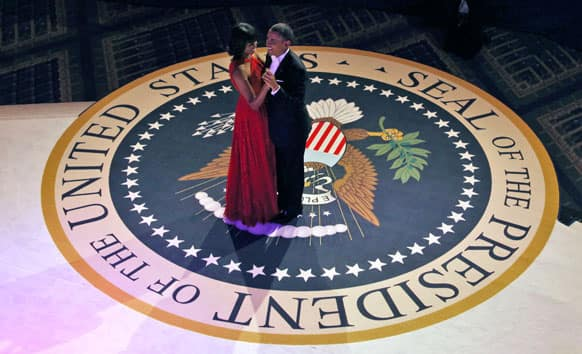 President Barack Obama and first lady Michelle Obama dance at the Commander-in-Chief`s Inaugural Ball in Washington, at the Washington Convention Center during the 57th Presidential Inauguration.