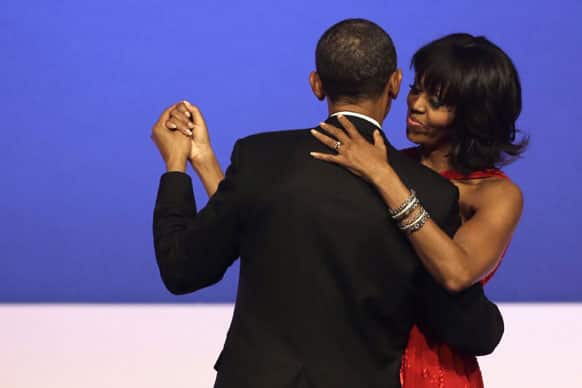 President Barack Obama and first lady Michelle Obama dance together at the Commander-in-Chief`s Inaugural Ball in Washington, at the Washington Convention Center during the 57th Presidential Inauguration.