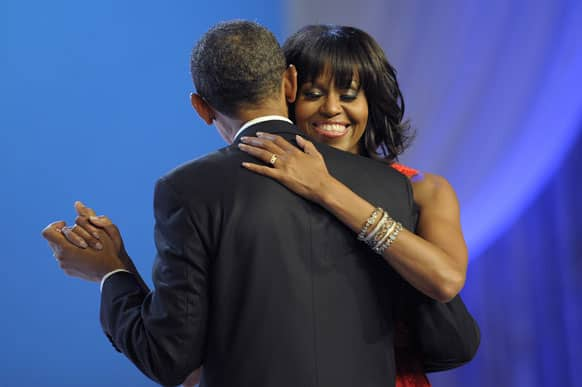 First lady Michelle Obama smiles has she dances with President Barack Obama during The Inaugural Ball at the Washignton convention center during the 57th Presidential Inauguration.
