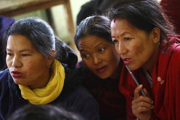 Nepalese women attend a literacy class for women in Basundhara, Katmandu.