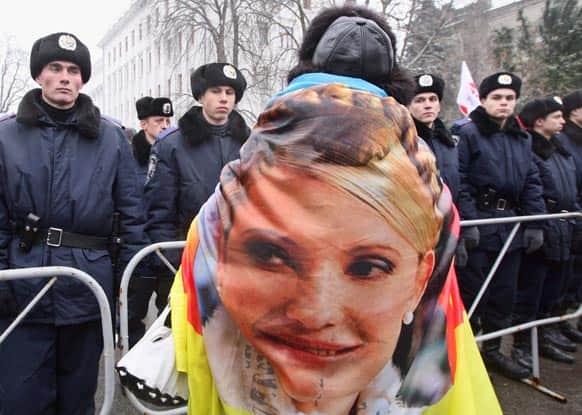 A supporter of former Ukrainian Prime Minister Yulia Tymoshenko take part in a rally outside Ukraine`s Presidential office in Kiev, Ukraine.