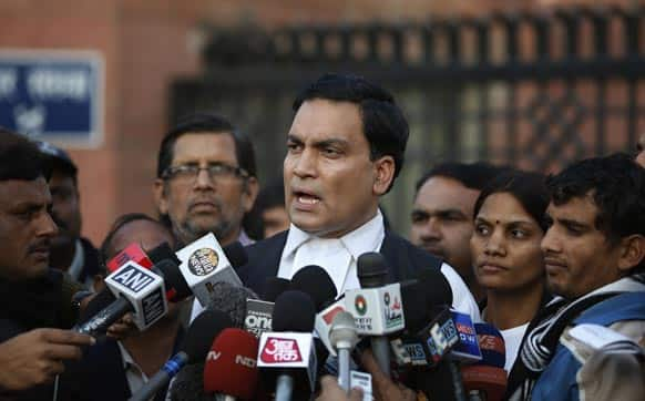 A.P Singh, lawyer for one of the accused, speaks to journalists outside the Saket district court complex where the five men facing charges of rape and murder of a 23-year-old woman aboard a moving bus in the capital last month stand trial, in New Delhi.