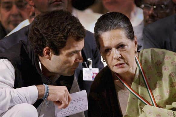 Rahul Gandhi, talks to his mother and party president Sonia Gandhi at a meeting of the party in Jaipur.