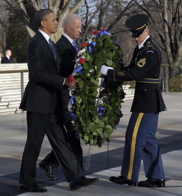 President Barack Obama and Vice President Joe Biden place a wreath at the Tomb of the Unknowns at Arlington National Cemetery in Arlington, Va.