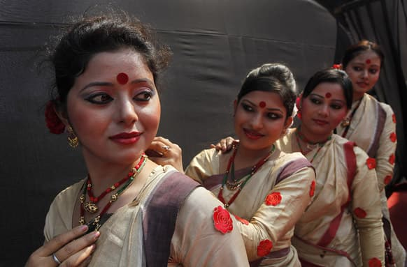 Assamese Bihu dancers in traditional outfit prepare to perform during the opening ceremony of the three-day International Tourism Mart in Guwahati.