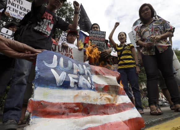 Protesters burn a mock American flag during a rally at the US Embassy in Manila to protest the recent incident in the Philippines wherein a US Navy minesweeper, USS Guardian, ran aground off Tubbataha Reef, a World Heritage Site in the Sulu Sea Manila.