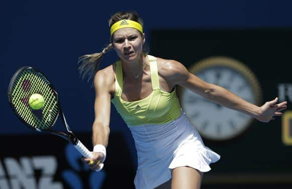 Russia`s Maria Kirilenko hits a forehand return to Belgium`s Yanina Wickmayer during their third round match at the Australian Open tennis championship in Melbourne.