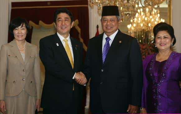 Japan`s Prime Minister Shinzo Abe, his wife Akie, pose for photos with Indonesia`s President Susilo Bambang Yudhoyono and his wife Ani Bambang Yudhoyono before a meeting at Merdeka Palace in Jakarta.