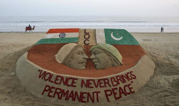 A sand sculpture carrying a message of peace in the wake of rising tension between India and neighboring Pakistan stands on the beach in Puri.
