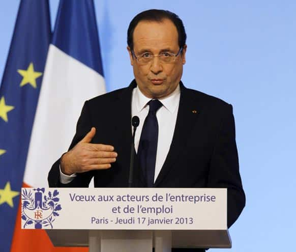 French President Francois Hollande delivers his speech, during the New Year wishes ceremony to union representatives and businessmen, at the Elysee Palace in Paris.