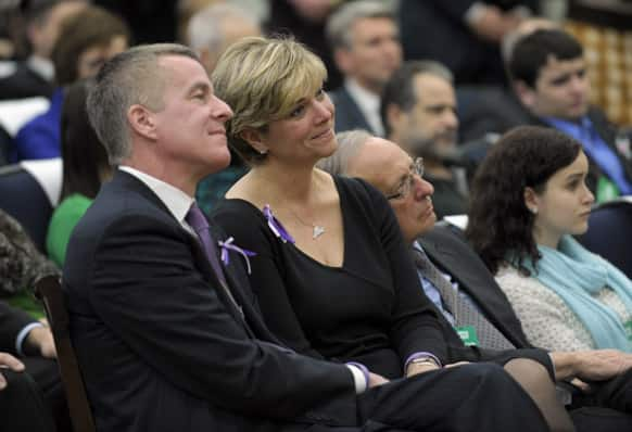 Lynn and Chris McDonnell, parents of Grace McDonnell who was killed in the Newtown, Conn. school shooting, listen as President Barack Obama talks about their daughter during a news conference on proposals to reduce gun violence.