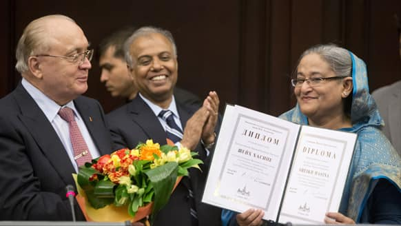 Bangladesh Prime Minister Sheikh Hasina, right, smiles receiving a diploma during her visit to the Moscow State University, in Moscow, Russia.