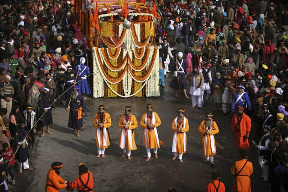 Sikh devotees take out a procession to celebrate the birth anniversary of Guru Gobind Singh in Jammu. The birth anniversary of Guru Gobind Singh, the tenth Sikh guru, will be marked on Jan 18.