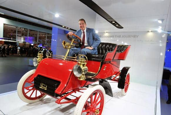 William Clay Ford Jr., Executive Chairman, Ford Motor Company, sits in a 1903 Ford Model A, the oldest surviving Ford product at the North American International Auto Show in Detroit.