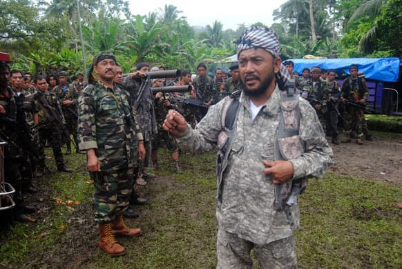 Khabir Malik, Commander of the Moro Islamic Liberation Front, a Muslim rebel group which signed a 1996 peace pact with the Philippine Government briefs his comrades at Patikul township, on the volatile island of Jolo in southern Philippines.