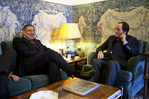 US Defense Secretary Leon Panetta, left, meets with Portugal`s Foreign Minister Paulo Portas at the Ministry of Foreign Affairs in Lisbon, Portugal