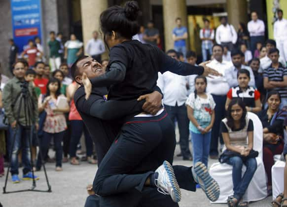 People watch a self defense training program at a shopping mall in Mumbai.