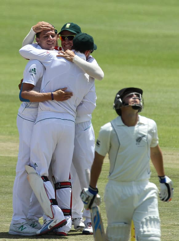 Dale Steyn celebrates with teammates after bowling New Zealand`s batsman BJ Watling on day four of their second cricket test match at the St Georges Stadium in Port Elizabeth, South Africa.