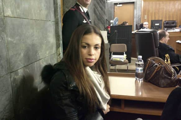 Karima el-Mahroug, the Moroccan woman at the center of ex-Premier Silvio Berlusconi`s sex-for-hire trial, sits in a court room prior to testifying as a witness for the first time, in Milan.