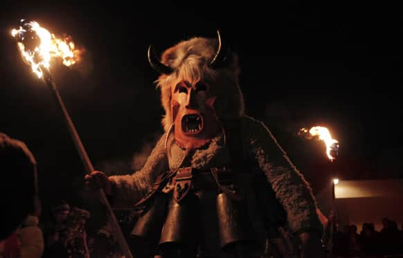 A Bulgarian masked Kukeri dancer performs a ritual in the town of Batanovtsi.