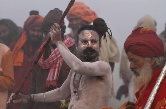A naked Hindu holy men, or a Naga Sadhu, performs a ritual at Sangam, the confluence of rivers Ganges, Yamuna and mythical Saraswati, ahead of the Maha Kumbh Mela, in Allahabad.