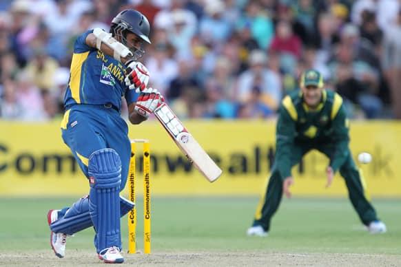 Sri Lanka`s Lahiru Thirimanne, left, drives the ball against Australia during their One Day International cricket match in Adelaide.