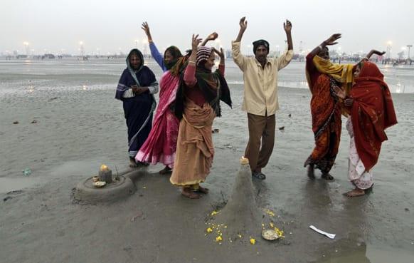 Hindu devotees dance as they perform a ritual on the beach in Gangasagar.