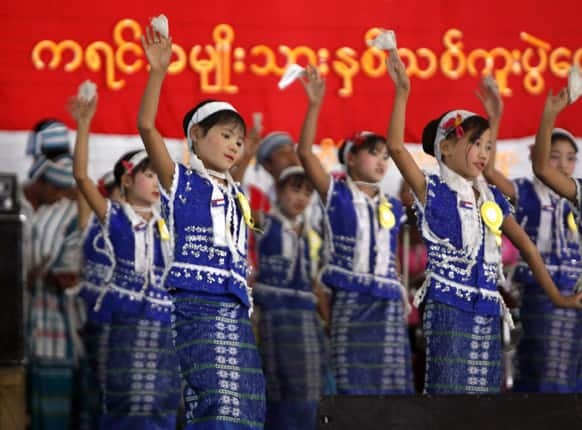 An ethnic Karen children artist troupe, clad in traditional dresses, performs during Karen New Year celebrations at National Race Village in Yangon, Myanmar.