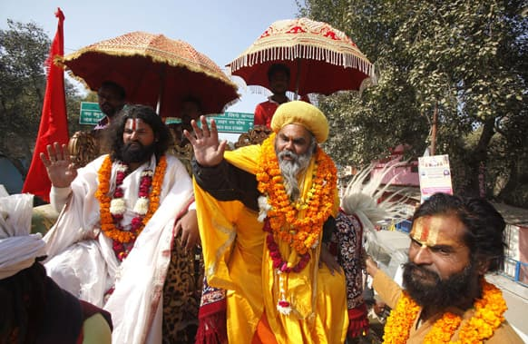 Sadhus, or Hindu holy men, arrive in a religious procession to participate in the Maha Kumbh Mela at the Sangam, the confluence of rivers Ganges, Yamuna and mythical Saraswati, in Allahabad.