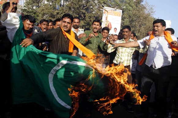 Activists of the right wing Hindu nationalist Vishwa Hindu Parishad, or World Hindu Council, burn a Pakistani flag during a protest in Ahmadabad.