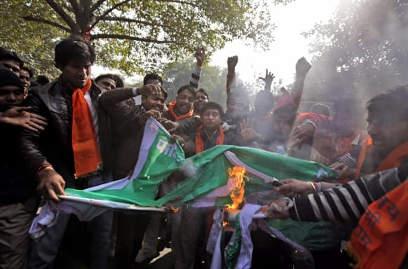 Activists of the right wing Hindu nationalist Bajrang Dal set fire to a Pakistani flag during a protest in New Delhi.