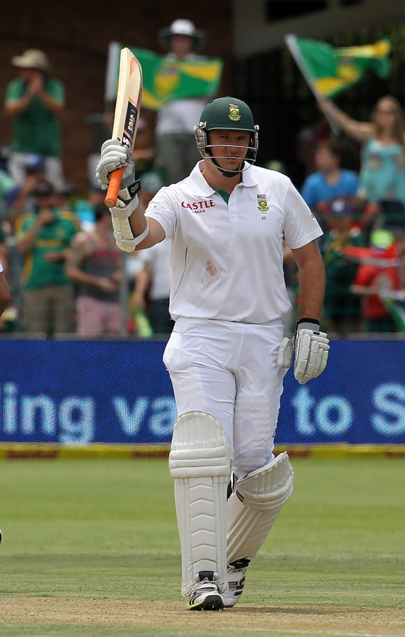 South Africa`s captain Graeme Smith waves bat to celebrate his half century on the day one of their second cricket test match against New Zealand at the St Georges Stadium in Port Elizabeth, South Africa.