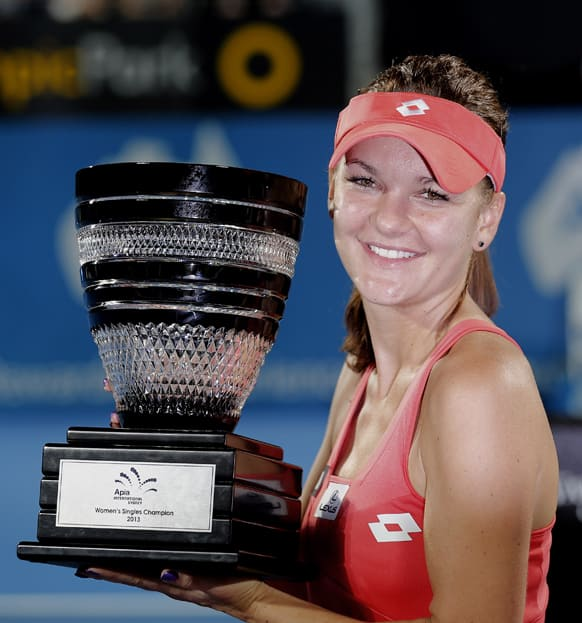 Poland`s Agnieszka Radwanska holds the winner`s trophy after defeating Slovakia`s Dominika Cibulkova in their women`s final match at the Sydney International Tennis tournament in Sydney.