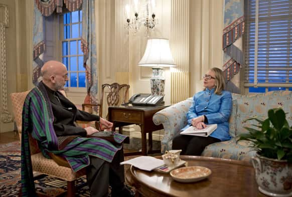 Secretary of State Hillary Rodham Clinton meets with Afghanistan President Hamid Karzai, left, at the State Department in Washington.