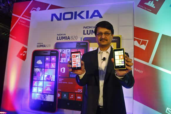 Viral Oza, Director Marketing Nokia India, introduces Nokia`s newest smartphone, the Lumia 920, equipped with Microsoft`s Windows Phone 8, in Bangalore.