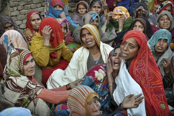 The wife of Indian Army soldier Lance Naik Hamraj, left, who was allegedly killed by Pakistani soldiers on the line-of-control in Kashmir, mourns before his funeral in Mathura district, Utter Pradesh, India.
