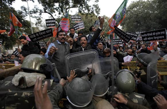 Supporters of India`s main opposition Bharatiya Janta Party (BJP) shout slogans as they try to cross a police barricade during a protest against Pakistan in New Delhi, India.