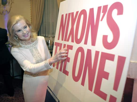 Trisha Nixon Cox, daughter of President Richard Nixon, looks at a reproduction of one of her father`s campaign signs during the Richard Nixon Centennial Birthday Celebration in Washington.