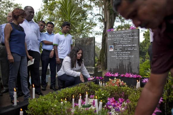 Extended family members, friends and law-makers pay tribute at the grave of slain newspaper editor Lasantha Wickrematunge, on his fourth death anniversary in Colombo, Sri Lanka.