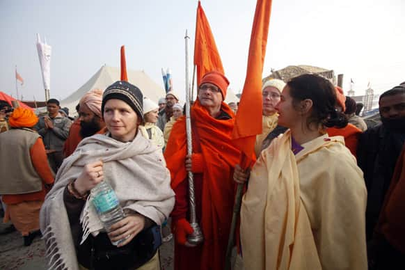Foreign Hindu devotees arrive for a religious procession towards the Sangam, the confluence of rivers Ganges, Yamuna and mythical Saraswati, as part of the Mahakumbh festival in Allahabad.