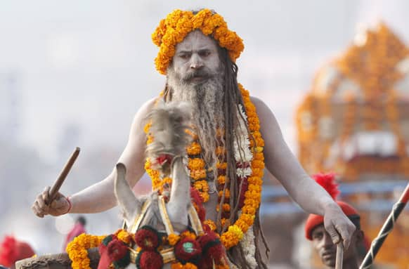 A Naga Sadhus, or Naked Hindu holy man, participate in a religious procession towards the Sangam, the confluence of rivers Ganges, Yamuna and mythical Saraswati, as part of the Mahakumbh festival in Allahabad.