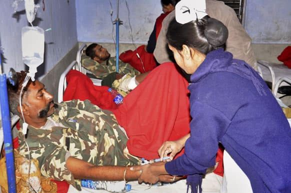 Central Reserve Police Force (CRPF) soldiers, in uniform, are treated at a hospital in Daltangunj, Jharkhand.