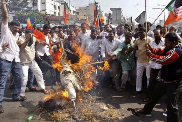 Activists of the opposition party of Indian Bharatiya Janata Party (BJP) shout slogans and burn an effigy of Majlis-e-Ittehadul Muslimeen (MIM) leader Akbaruddin Owaisi during a protest against his alleged hate speech in Hyderabad.