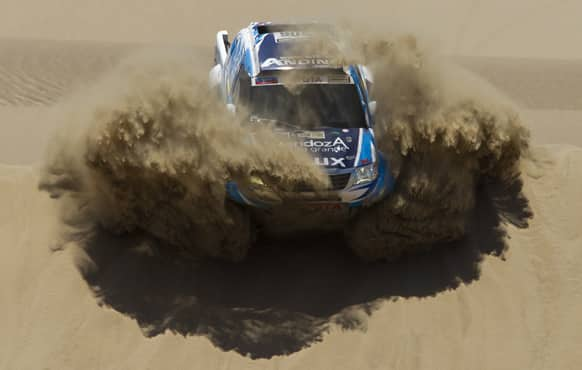 Totoya`s Lucio Alvarez and co-driver Bernardo Graue of Argentina compete in the 1st stage of the 2013 Dakar Rally between Lima Pisco, Peru.