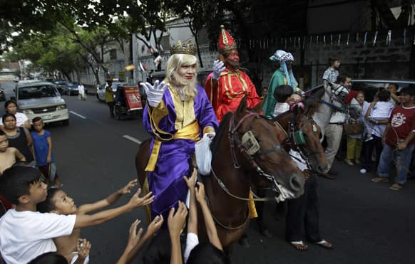 Filipino kids scramble to get candies given by men dressed as the Three Kings during Epiphany celebrations in Manila.
