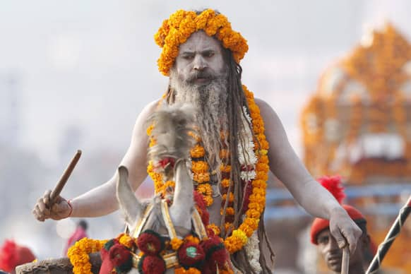 A Naga Sadhus participate in a religious procession towards the Sangam, the confluence of rivers Ganges, Yamuna and mythical Saraswati, as part of the Mahakumbh festival in Allahabad.