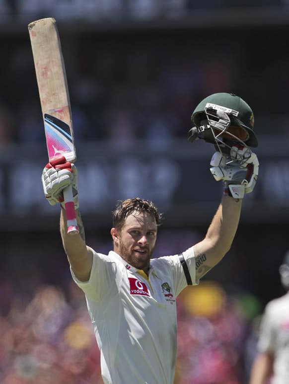 Australia`s Matthew Wade leaps high celebrating hitting a century on day three of their third cricket test match against Sri Lanka in Sydney, Australia.